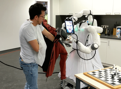 helps a person in need of assistance into the jacket.   © University of Bonn, Autonomous Intelligent Systems